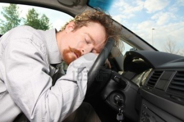 4554560-tired-driver-sleeps-in-a-car